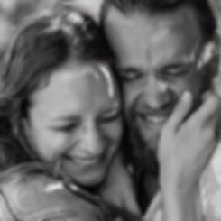 close up of couples faces laughing