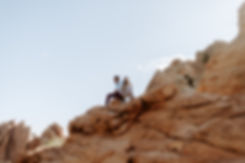 couple sits on a rock at garden of the gods in colorado