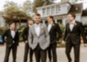 groom in checkered blazer with groomsmen