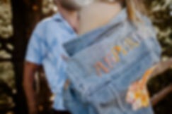 close up of girls blue jean jacket with russian stitching