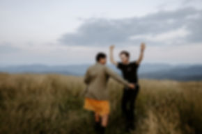 couple dances in mountain field at max patch