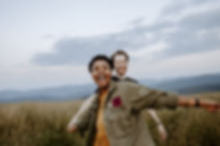 couple laughs and dances in mounain field at max patch