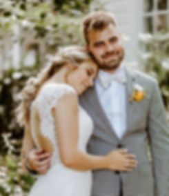bride with braid leans head on grooms shoulder