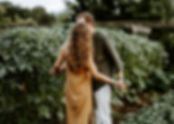 couple holding hands in a vineyard at furman university