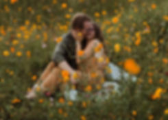 engaged couple kissing in wildflowers