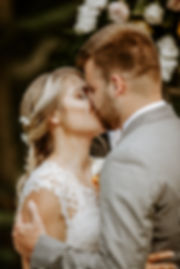 close up of bride and groom kiss
