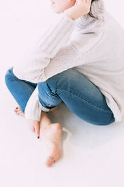 woman-in-gray-sweater-and-blue-denim-jea