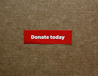 words-donate-today-on-a-piece-of-red-pap
