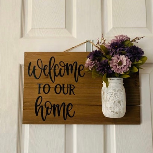 Welcome sign with mason jar and flowers