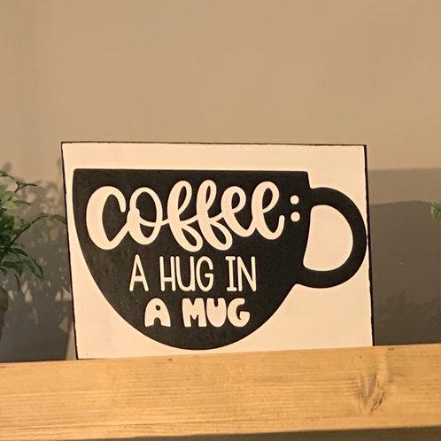 Coffee: A hug in a mug sign