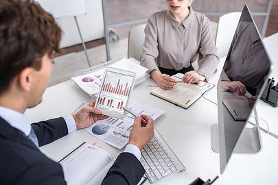 Business-people-analyzing-marketing-604634.JPG