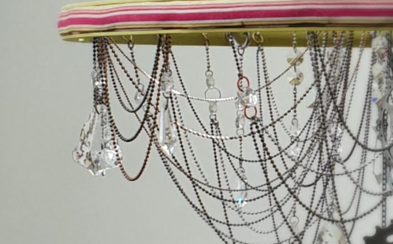 detail of ribbon wheel chandelier