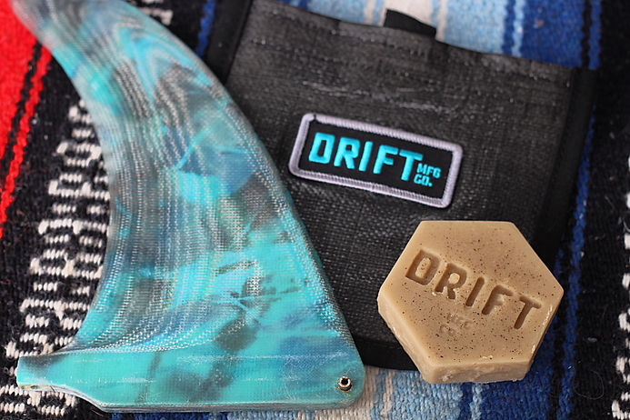 Dirft Mfg Co's hand shaped single fin, bees wax natural Surf Wax and our patched wax wallet or carrying your surfwax and fin keys
