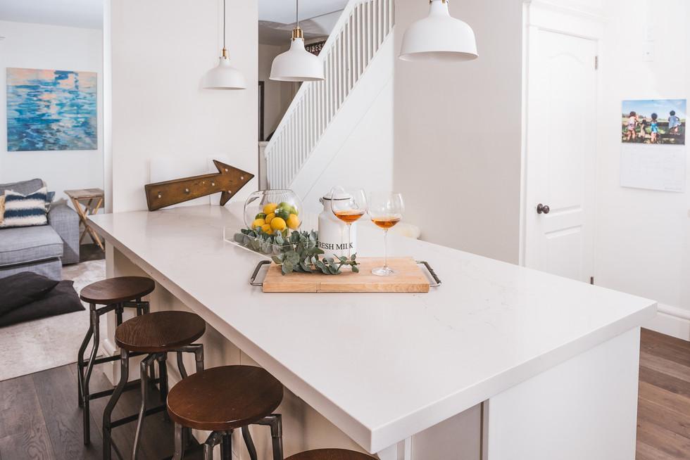 Clean modern, white kitchen island