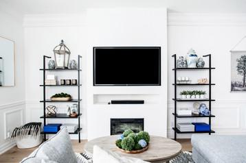 Floating metal shelves tv and fireplace build out toronto custom home build ac interiors design