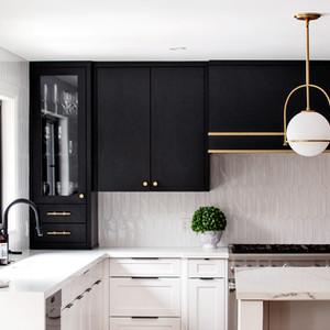 Transitional black, white, gold kitchen