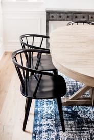 black wishbone chair with blue vintage rug ac interiors design