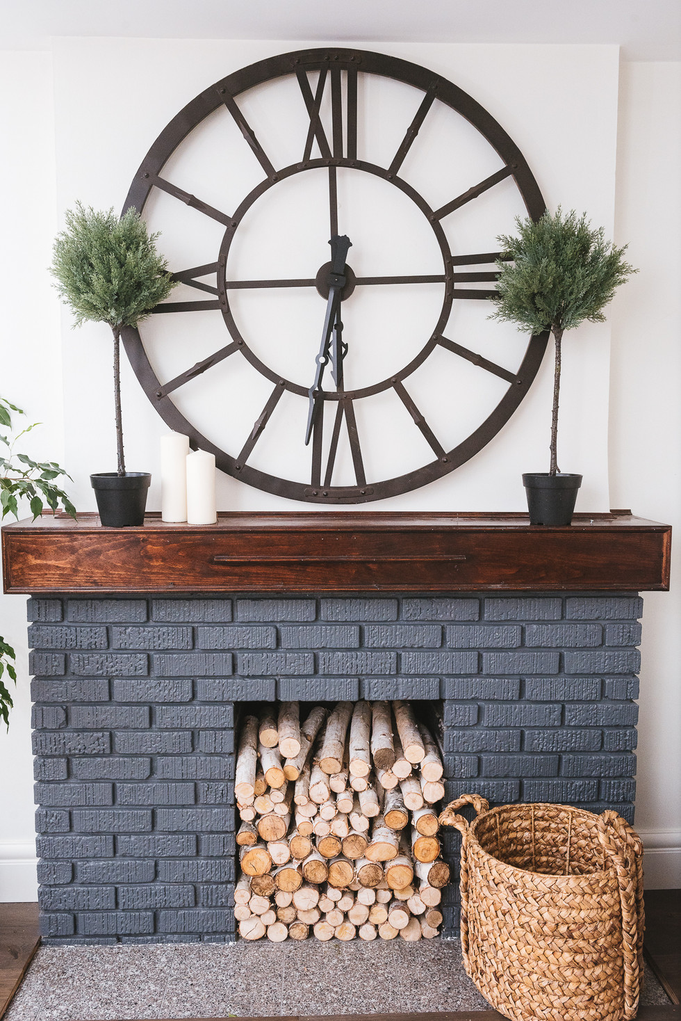 Fireplace, updated with grey paint and wooden beam