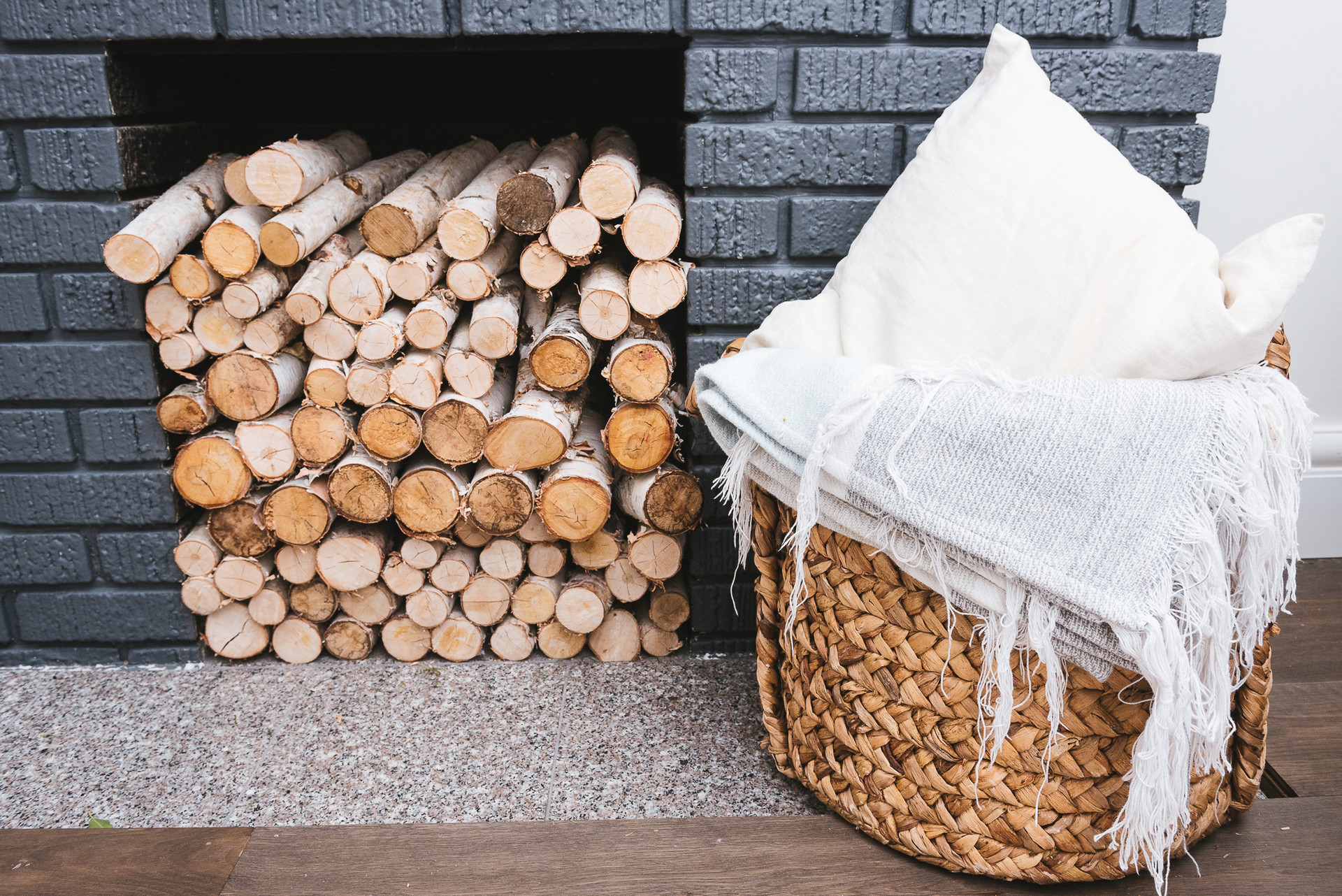 stacked wood inside fireplace