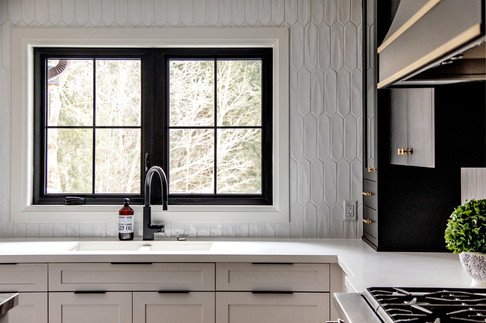 Black windows interior Black windows with grills white tile backsplash to the ceiling