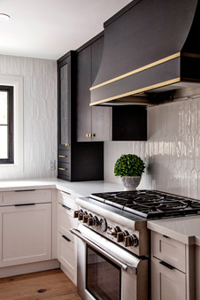 Black and gold hood modern kitchen thermadore range