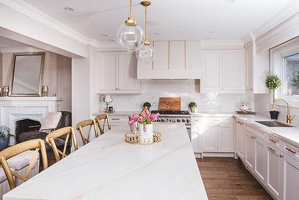 White and gold kitchen, white and gold kitchen hood, white cabinets gold hardware, L shape kitchen layout, interior designer toronto, AC interiors design, top toronto designers