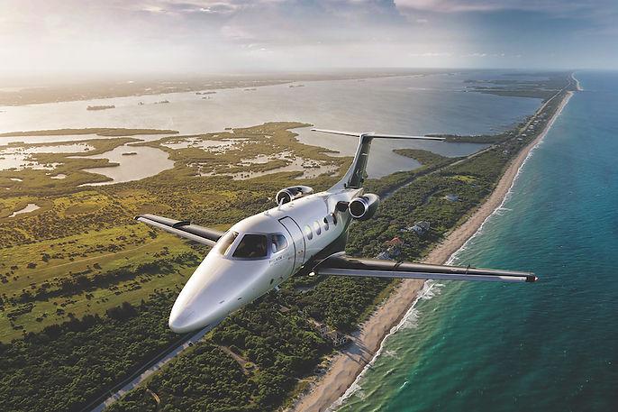 Phenom100EV_Exterior-Flight-Ocean.jpg