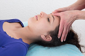 Young attractive girl having head massage at spa resort.jpg