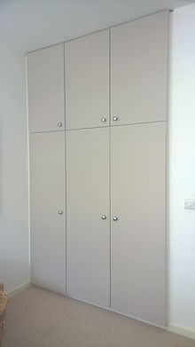 Fitted wardrobe with flush doors.