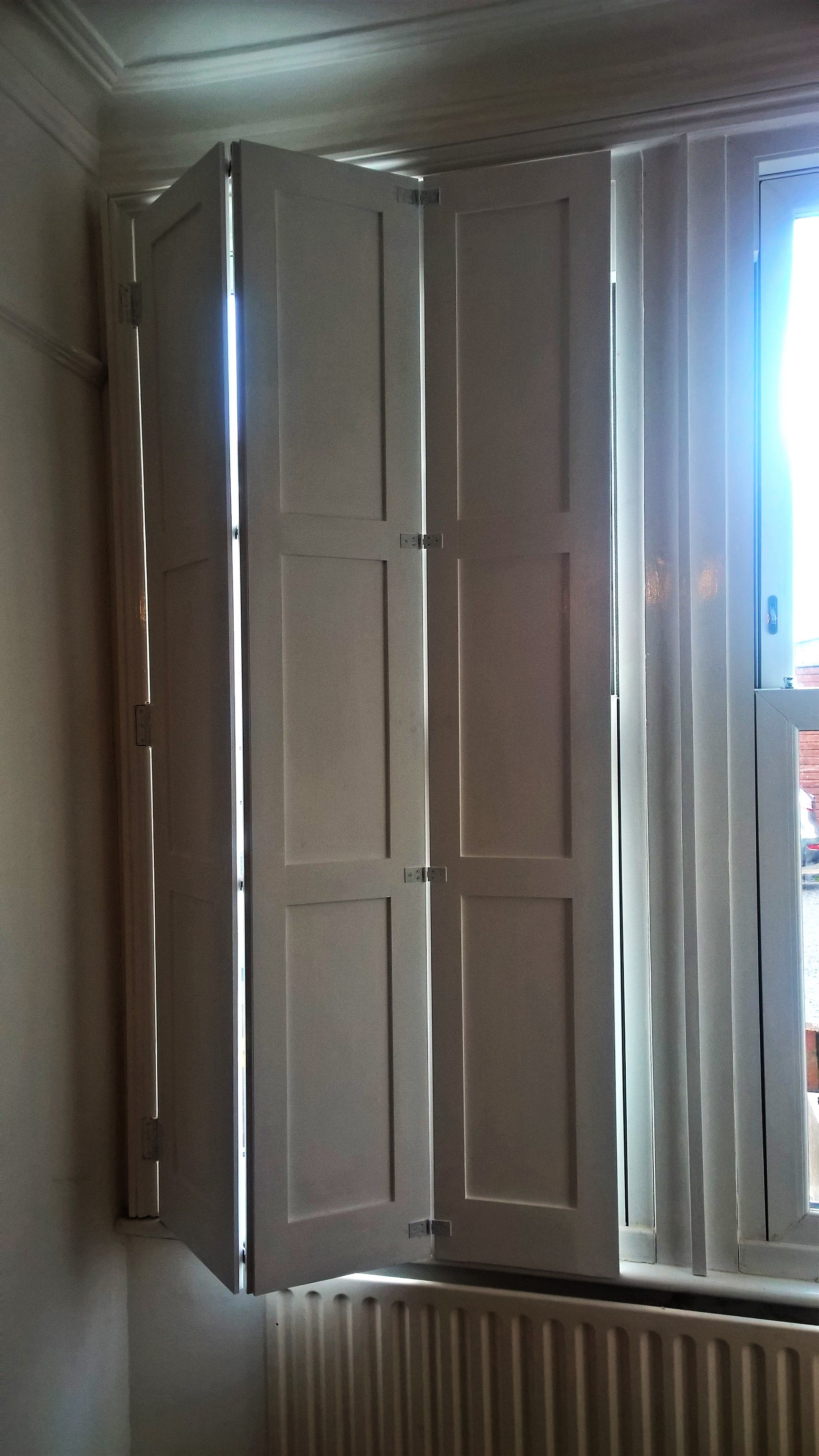 Solid shutters in the Shaker style.