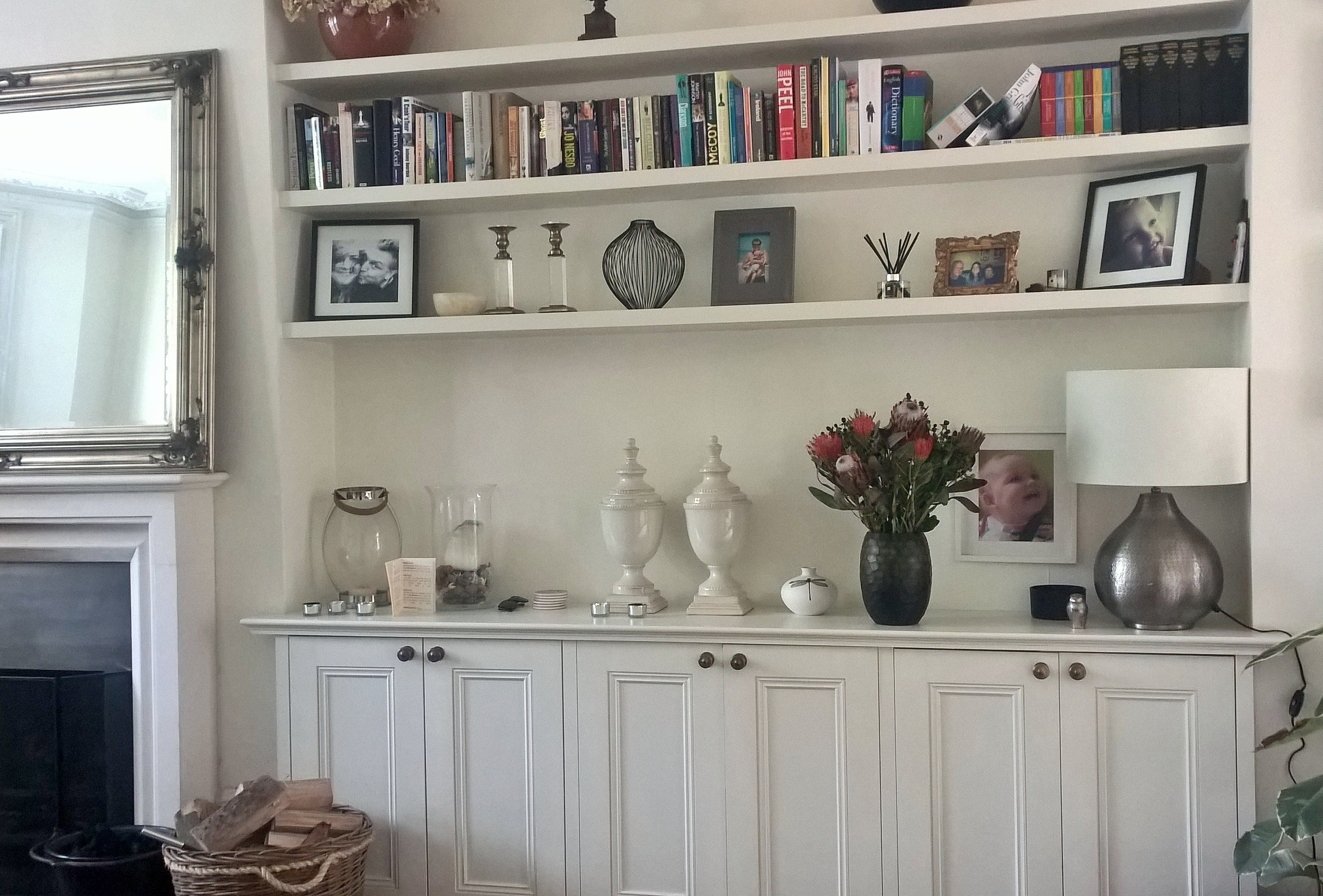 Long floating shelves with ow of low