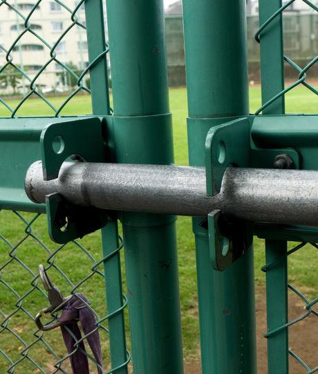 Locked gate entrance to Japanese basebal
