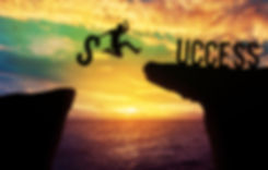 Silhouette man holding S text while jump