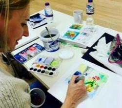 Deborah Kreczmer busy painting her wonderful flowers