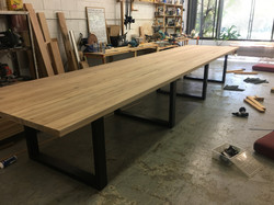 Raw State Blackbutt Boardroom Table with Matte Black Steel Loops