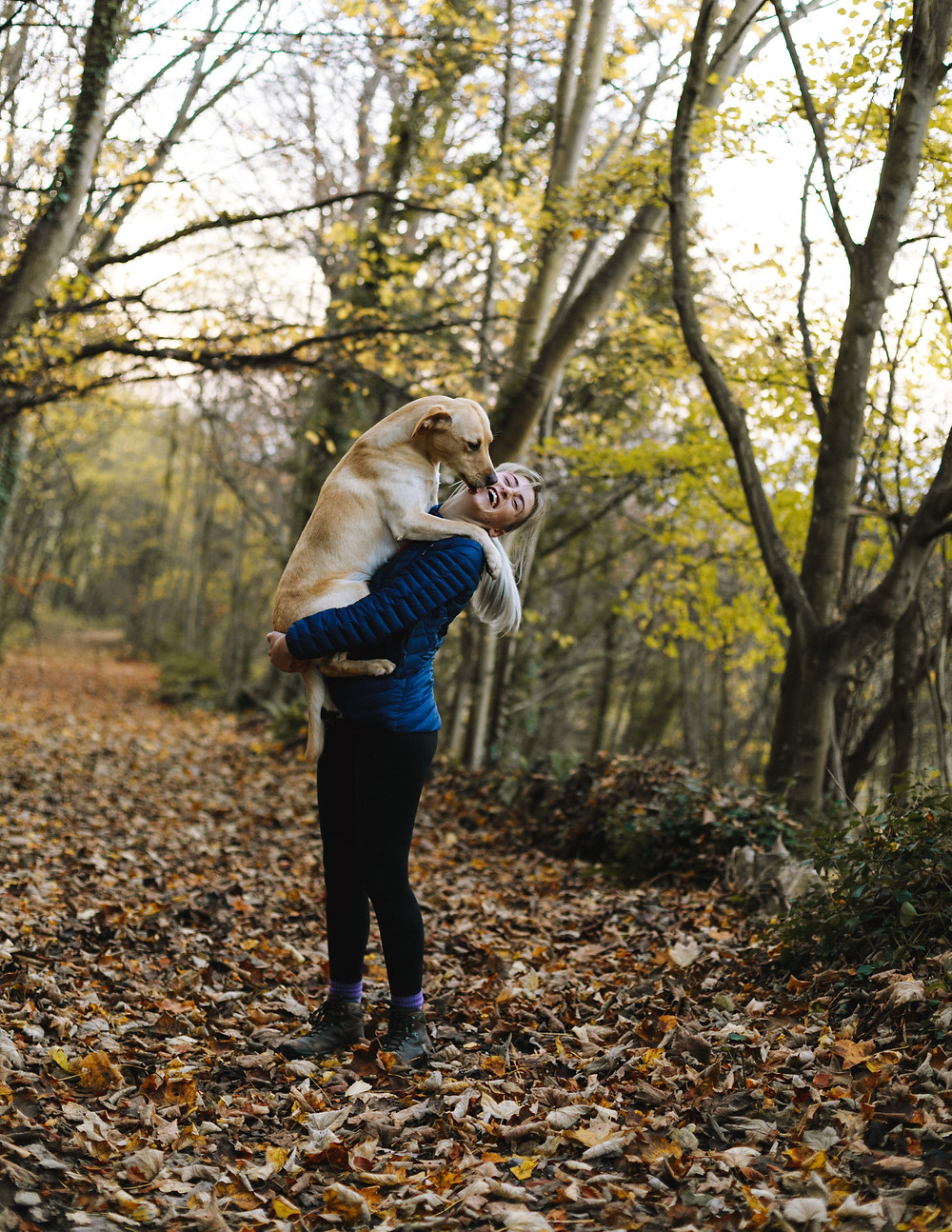 Dog hugging a lady in the woods after eating raw dog food
