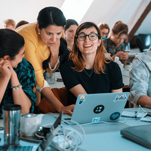 Photo of three women working on hackathon project
