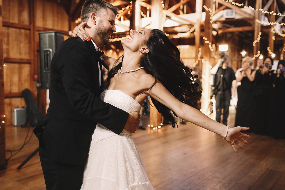 Bride shakes her dark hair while dancing