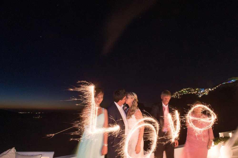 Tips for eloping in Santorini Greece - sparklers are cheaper than fireworks