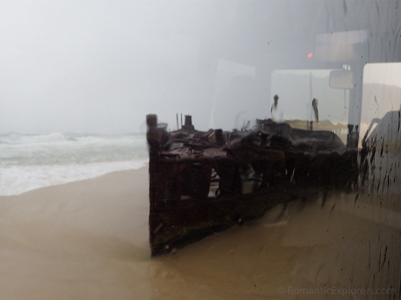 View of the Maheno Shipwreck through the window of our tour bus on a rainy day.