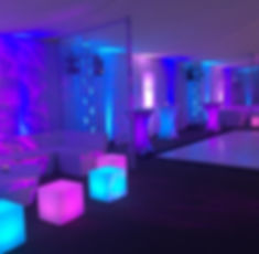 Inside the Beaverwood with lit LED cubes and tables