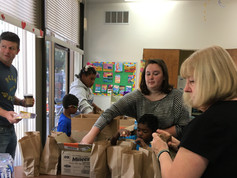 Volunteers making lunches