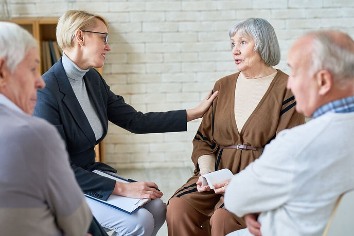 woman-consoling-senior-patients-on-meeti