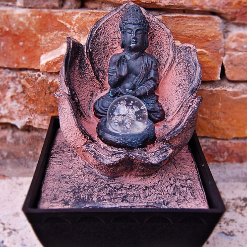 buddha fountain with crystal ball