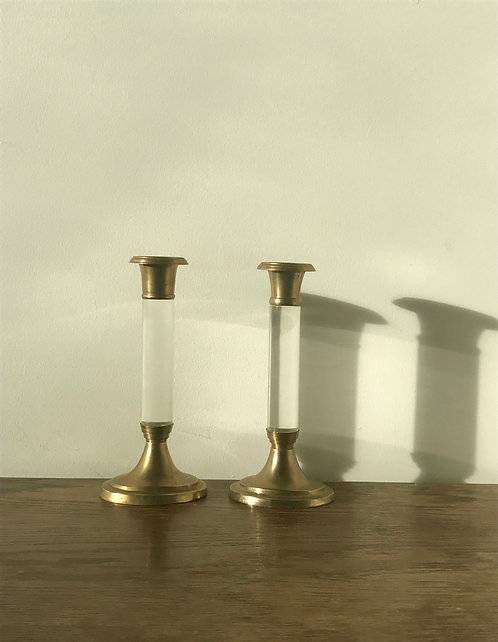 A Pair of Lucite and brass candle sticks
