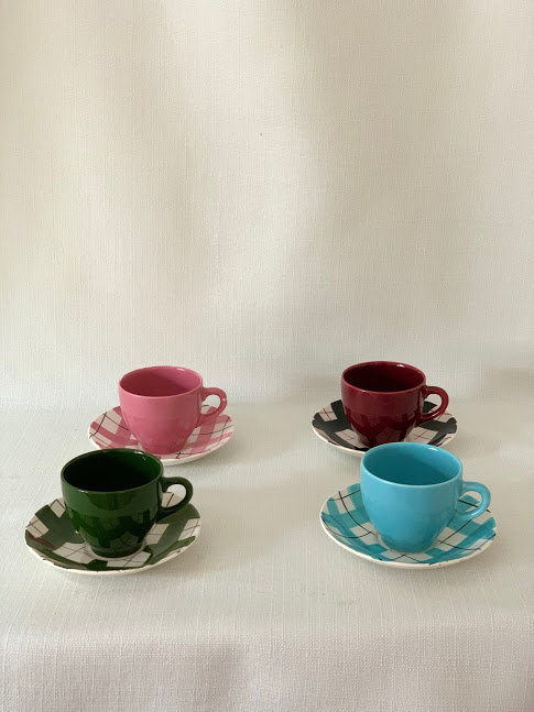 Set of Four Colourful Cups & Saucers.