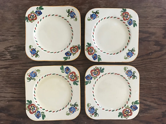 A Set of Four Art Deco Bursley Ware Hand Painted Side Plates