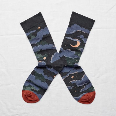 Pair of Bonne Maison Socks showing the sky at night.