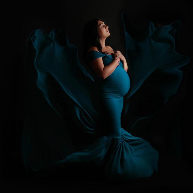 pregant mom in gown in studio