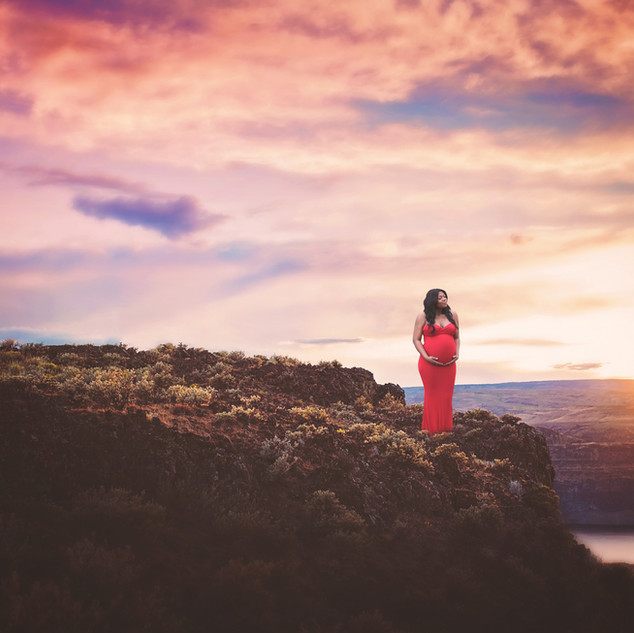 beautiful sky, pregnant woman standing on cliff